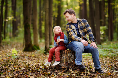 Little boy with his father during stroll in the forest. Active family time on nature. Hike with little kids