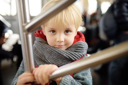Little boy in new York subway car. Family travel with children. Фото со стока