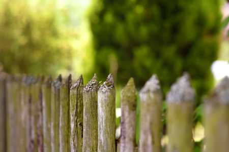 Picturesque old wooden fence in in secluded countryside of Switzerland. Travel by Swiss.