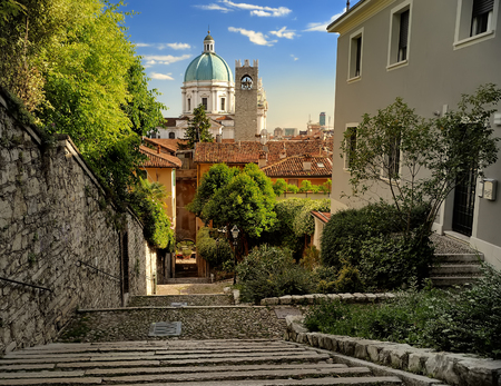 Beautiful sunset view of the Duomo cupola over the town Brescia in Lombardy. Travel by Italy. Imagens