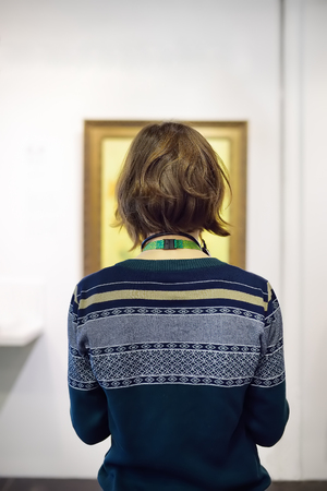 Visitor looks at the paintings by Vincent van Gogh in the Museum Van Gogh in Amsterdam, Netherlands.