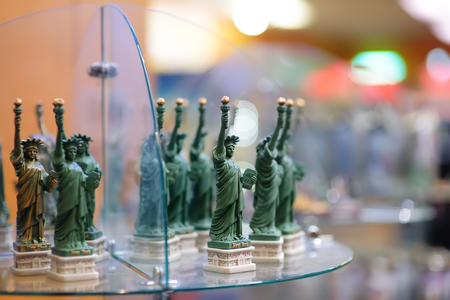 Statuettes of famous sculpture Statue of Liberty in the shop of New York, USA. Souvenirs from the trip.