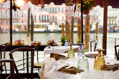 Stylish outdoor cafe in Venice. Sightseeng tour in Italy.