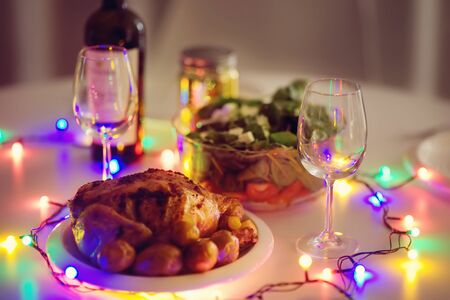 Toned photo of romantic supper for pair in New year eve. Homemade organic food. Stock fotó
