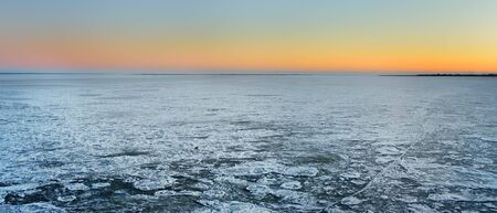 Amazing view of frozen sea surface during crossing on the ferry boat. Travel by water in winter.