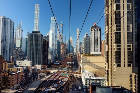NEW YORK, USA - DECEMBER 23, 2019: Ed Koch Queensboro Bridge from Manhattan to Queens and famous Roosevelt Island cable tramway. Shot makes from cabin of RIT. Transport of New York.
