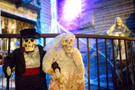 New York, USA - October 20, 2018: Halloween decoration in chelsea market at evening. Wedding pair of scary skeletons. Halloween - traditional american autumn holiday.