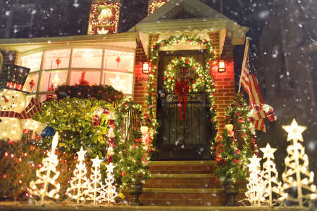 New York, USA - December 26, 2019: A street, house and porch decorated for Christmas and New Year in the Dyker Heights neighborhood. Winter holidays vibe on Xmas eve in NYC.