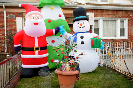 New York, USA - December 25, 2019: A street, house and porch decorated for Christmas and New Year in the Dyker Heights neighborhood. Winter holidays vibe on Xmas eve in NYC.