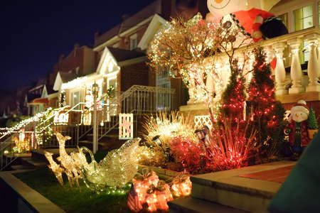 A street decorated for Christmas and New Year holidays in the Dyker Heights neighborhood, New York, USA. Evening magical vibe on Xmas eve in NYC.