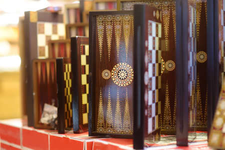 Sale of backgammon in grand bazaar in Istanbul, Turkey. It is traditional board eastern game. Authentic gifts, keepsakes and souvenirs from travels by Turkey.