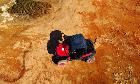 Aerial view of buggy car on the sandy on the sea coast of Cyprus or Greek in summer. Extreme trip off road place. Lovely outdoor adventure for tourists Standard-Bild