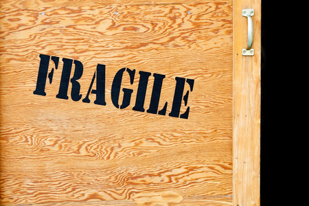 A wooden crate marked with the word fragile 写真素材