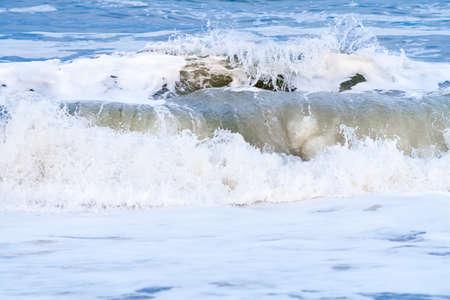 Close up of ocean waves crashing into the shore at Assateague Island National Seashore, Maryland