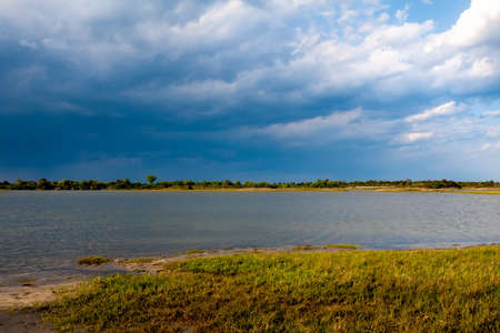 Salt marsh wetlands under a cloudy sky with rain in the distance at Assateague Island National Seashore, Maryland 版權商用圖片