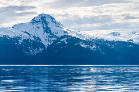 Snow-capped mountains along the coast of southern Alaska