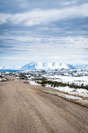 Scenic view of snow-covered mountains from the Klondike Highway at Summit Lake, British Columbia, Canada