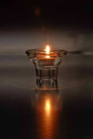 Lone Tea Light Candle Stock Photo