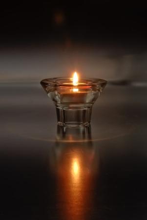 Lone Tea Light Candle Stock Photo
