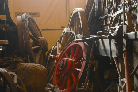 Red painted wagon wheel in neutral coloured sunlit workshop