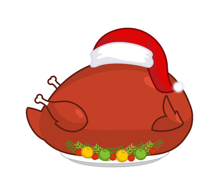 Big Roast turkey in Santa Claus cap. Christmas fowl on plate with vegetables. Fried chicken in festive red hat. holiday food for new year