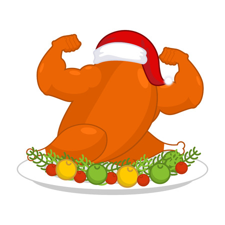 Christmas turkey strong in Santa red cap. Fitness food for New Year. powerful chicken on plate. Roast fowl on dish with vegetables