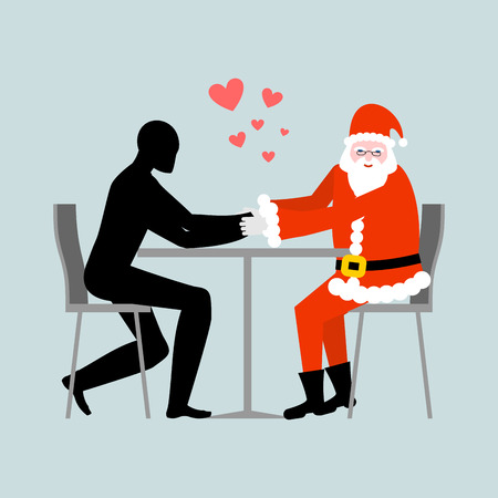 rendezvous: Christmas Lover. Lovers in cafe. Man and Santa Claus sitting at table. Christmas in restaurant. Romantic rendezvous are new year
