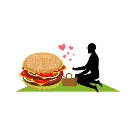 lover fast food. Man and hamburger on picnic. Guy and Burger. Meal in nature. blanket and basket for food on lawnt. Romantic date fastfood. Glutton Lifestyle