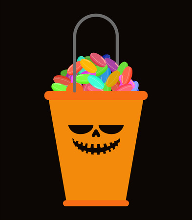 Orange Bucket candy for Halloween isolated. Traditional sweets feast of horror
