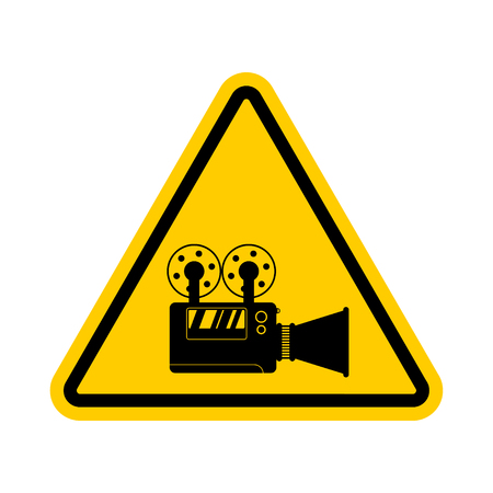 Attention video filming. Caution video fixing. Yellow road triangle sign and Video camera Ilustracja