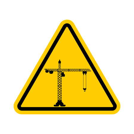 Attention Construction site. Caution development. Yellow road triangle sign Lifting crane