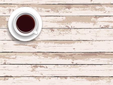 木製のテーブルの上にコーヒーを 1 杯