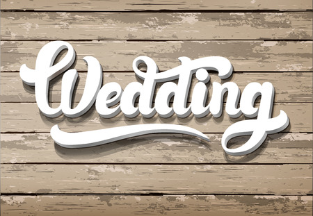 wedding table decor: The word Wedding on a wooden background. Horizontal boards
