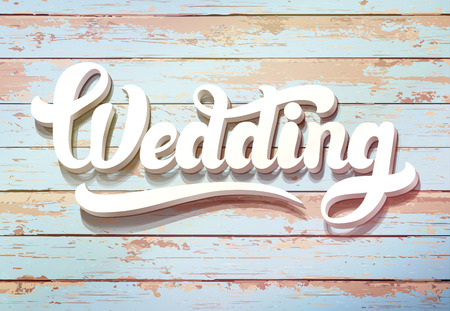 wedding table decor: The word Wedding on a wooden background. Wedding invitation vintage card