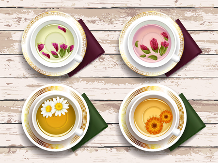 overhead view: Set of cups of herbal tea on a table with vintage texture. View from above