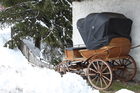 Old carriage in the snow photo