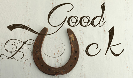 good wishes: Horseshoe on a vintage background - Good luck