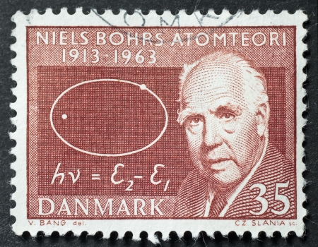 manhattan project: DENMARK – CIRCA 1963: a stamp printed in Denmark shows image of Niels Bohr, celebrating the fiftieth anniversary of his famous atomic theory Editorial