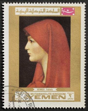 YEMEN � CIRCA 1969: a stamp printed in Yemen shows portrait of Fabiola, the famous picture from Jean Jacques Henner. Yemen, circa 1969 Stock Photo - 14947810