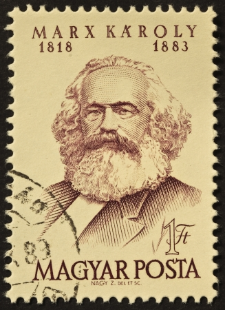 Karl Marx image in a cancelled stamp