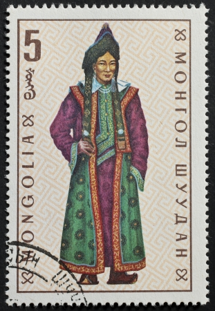 ceremonial clothing: MONGOLIA – CIRCA 1969: a stamp printed in Mongolia shows illustration of a mongolian traditional costume. Mongolia, circa 1969 Editorial