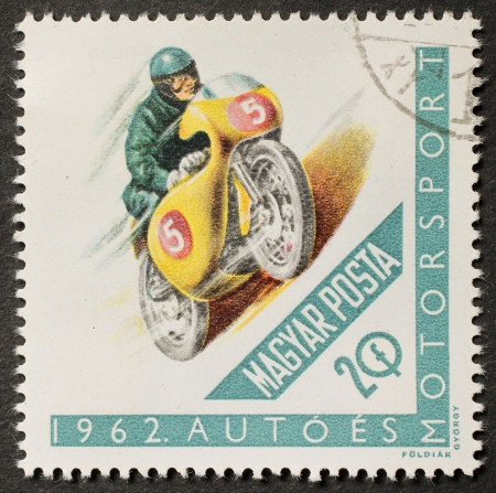 HUNGARY � CIRCA 1962: a stamp printed in Hungary shows illustration of a moto racer. Ungary, circa 1962