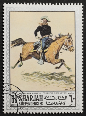 frederic: SHARJAH  UAE  – CIRCA 1969  a stamp printed in Sharjah  Emirate  shows a picture of a union horseman painted by Frederic Remington  Sharjah, circa 1969