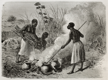 making a fire: Old illustration of beer making in Unyamwezi region, Tanzania. Created by Bayard, published on Le Tour du Monde, Paris, 1864