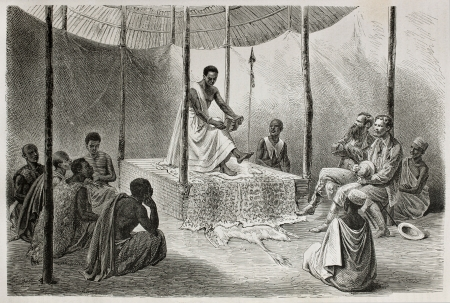 glancing: Old illustration of King Kamrasi (Ounyoro court, northern Uganda) glancing through the Bible. Created by Bayard, Trichon and Guillaume,  published on Le Tour du Monde, Paris, 1864