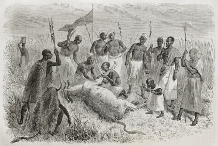 Old illustration of sorcerer performing magic rite in front of tribe members and King Kamrasis midget, north Uganda. Created by Bayard, Trichon and Monvoisin, publ. on Le Tour du Monde, Paris, 1864