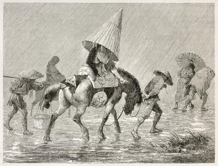 sotto la pioggia: Pack Horse giapponese sotto la pioggia, illustrazione vecchio. Creato da Bayard dopo schizzi giapponesi di autori ignoti, pubblicato Le Tour du Monde, Parigi, 1867