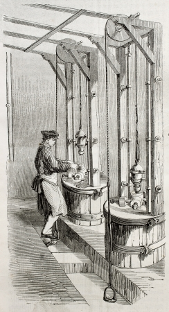 punch press: Old illustration of man working with punching machine in a needle factory. By unidentified author, published on Magasin Pittoresque, Paris, 1850