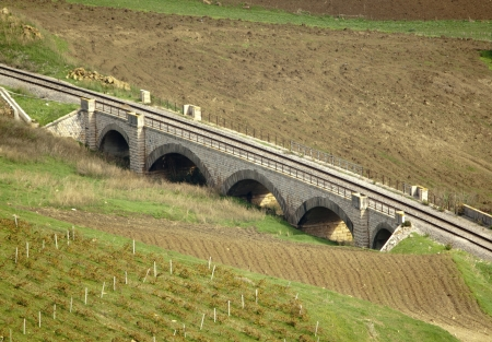 Old stone railway little bridge in the country photo