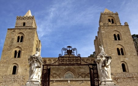 palermo italy: Cefal� cathedral entrance  marble statues on gate sides, Sicily